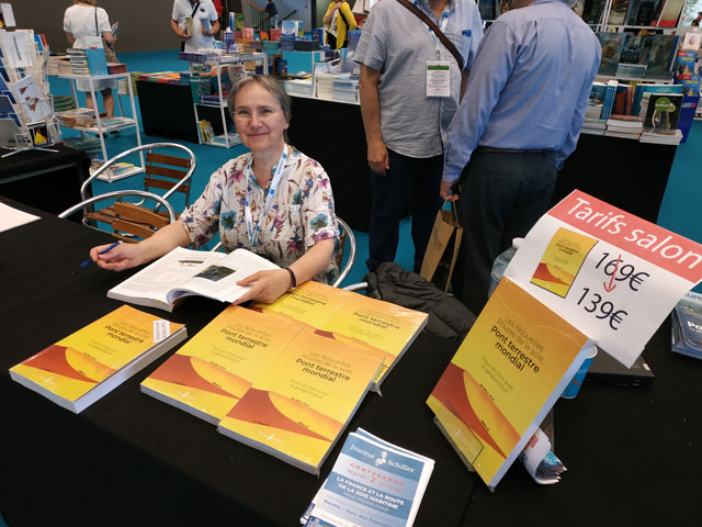 Odile Mojon at the literature table during the La Mer Expo.