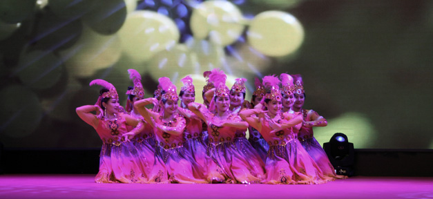 Beautiful Folk dance and projected images, Gaochang District vocational and training center (Turpan).